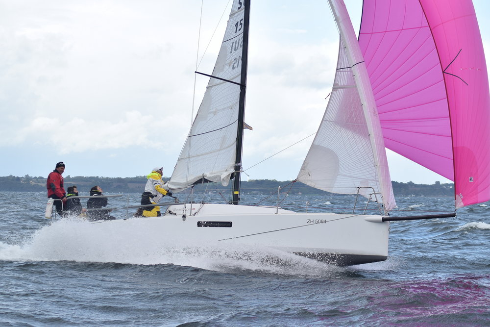 ESCAPADE with her reefed Tape-Drive Silver main, jib and fractional asymmetrical chute on the day she set the new speed record for a Seascape 27. All of her sails are original from 2013.