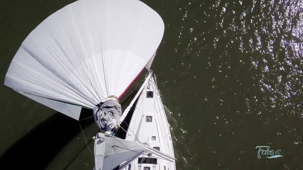 Above   : When the cruising chute is flying, the dousing sock sits on top of the sail.    Right   : The internal dousing sock halyard cannot tangle with the sail since it runs through its own section of the sock.