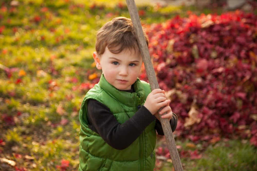 child holding rake