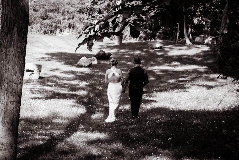 Couple walking in field wedding
