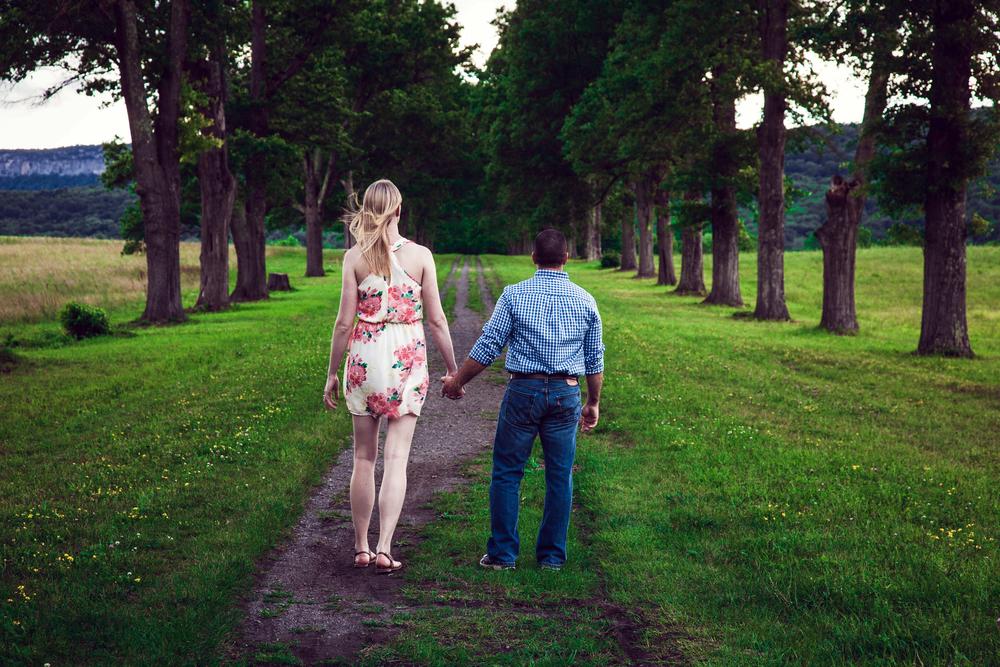couple walking through gatehouse in new paltz
