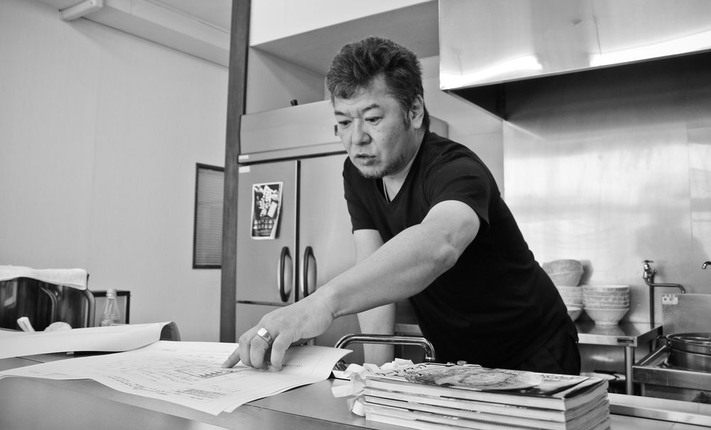 Ramen School Chief.  Shigekatsu Akimoto of Shoku no Dojo, explaining some of his kitchen designs.