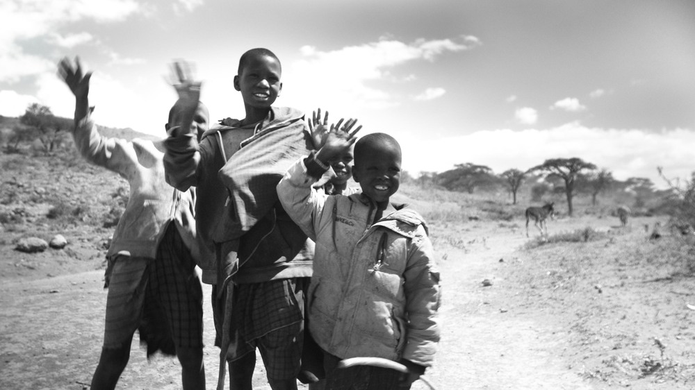 A still from the footage - Maasai boys waving goodbye