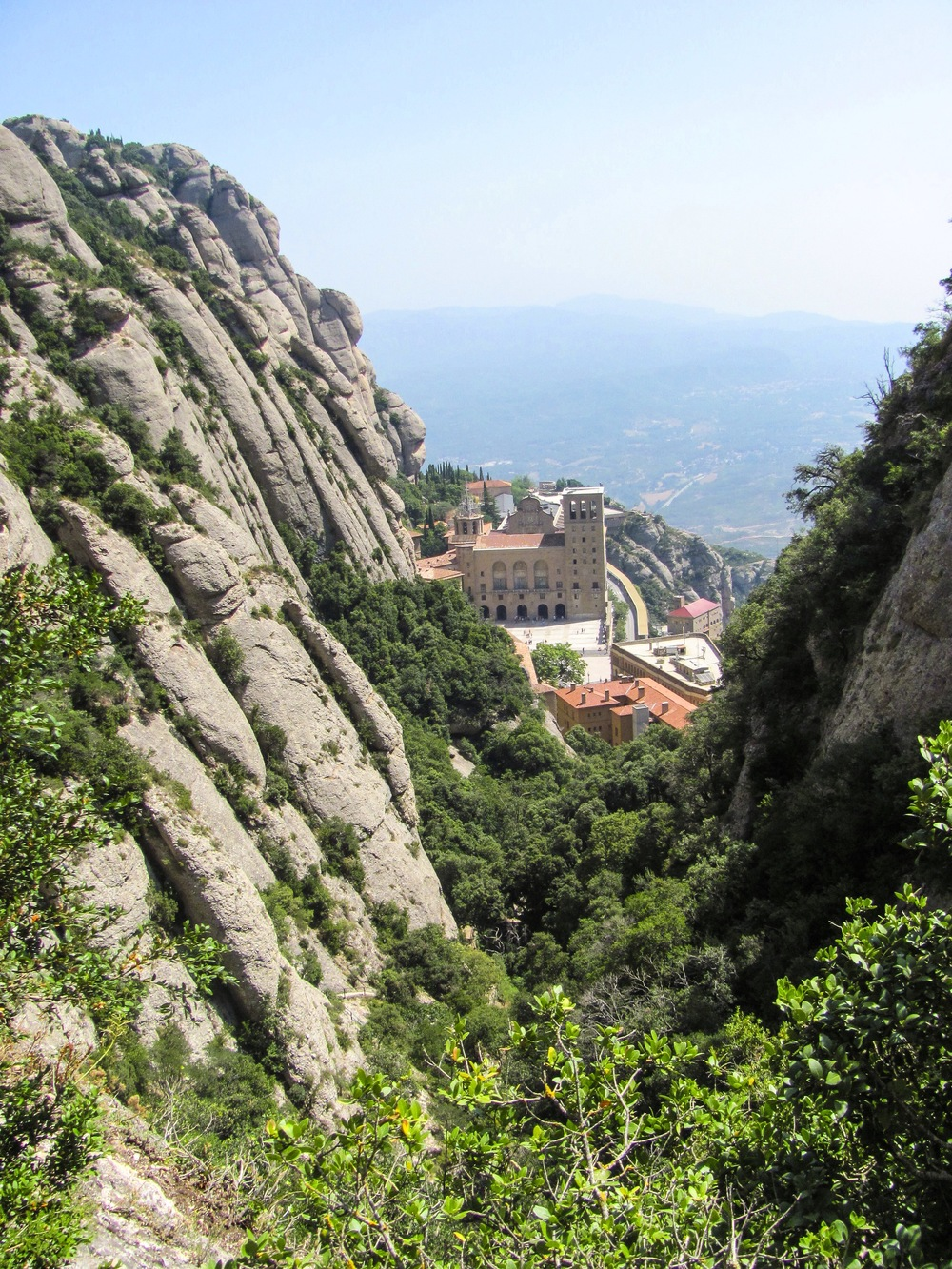 The Monastery tucked inside the enormity of the mountain.