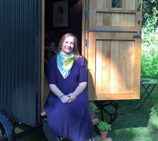 Author Tracy Chevalier on the steps of the orchard-inspired shepherd's hut at RHS Chelsea Flower Show 2016.