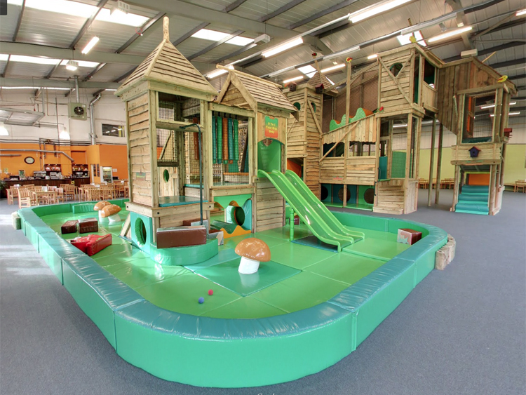 This indoor play area and cafe is a great example of how to make use of an empty cowshed