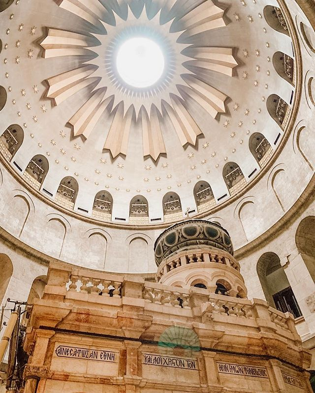 Inside of the Church of the Holy Sepulchre, where Jesus is believed to have been buried and resurrected! Visit this awesome site on your Holy Land tour! #eotours #travel #holysepulchre