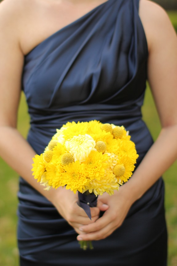 yellow bouquet with navy bridesmaids dresses at charleston wedding