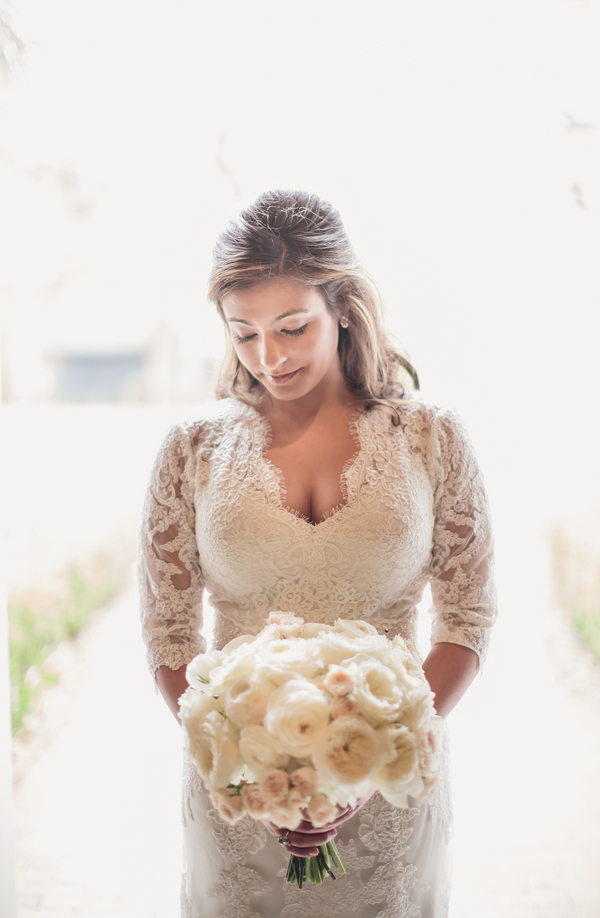 Charleston Bride in Lace Gown with Sleeves
