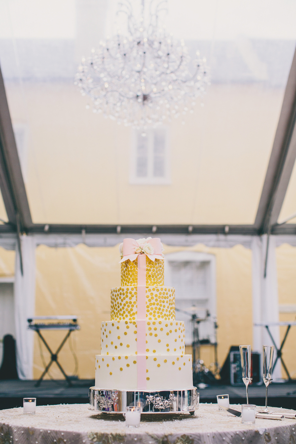 Gold wedding cake with pink ribbon at William Aiken House