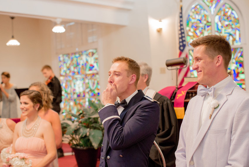 Groom's reaction as bride walks down the aisle