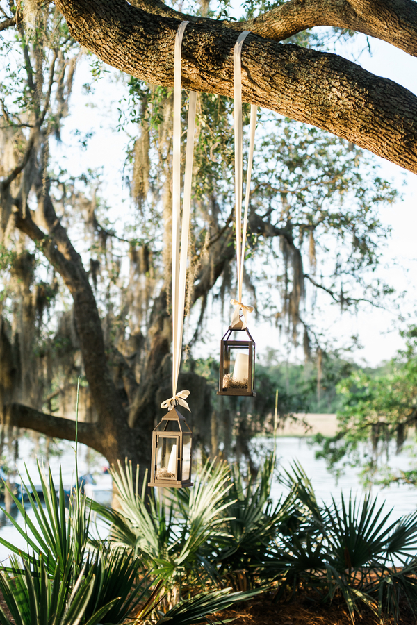Charleston wedding hanging lanterns at Creek Club at I'On by Alyona Photography