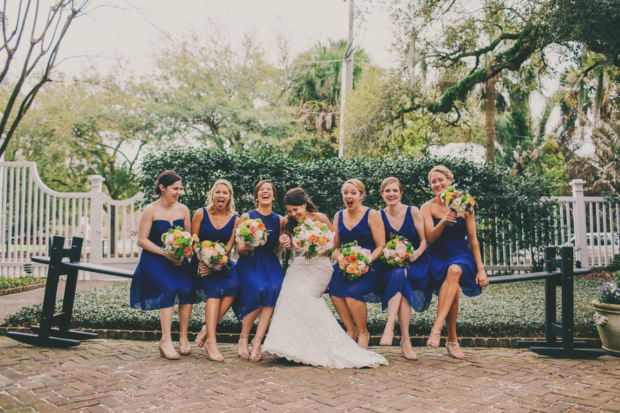 Charleston bridesmaids in royal blue on a joggling board by Hyer Images