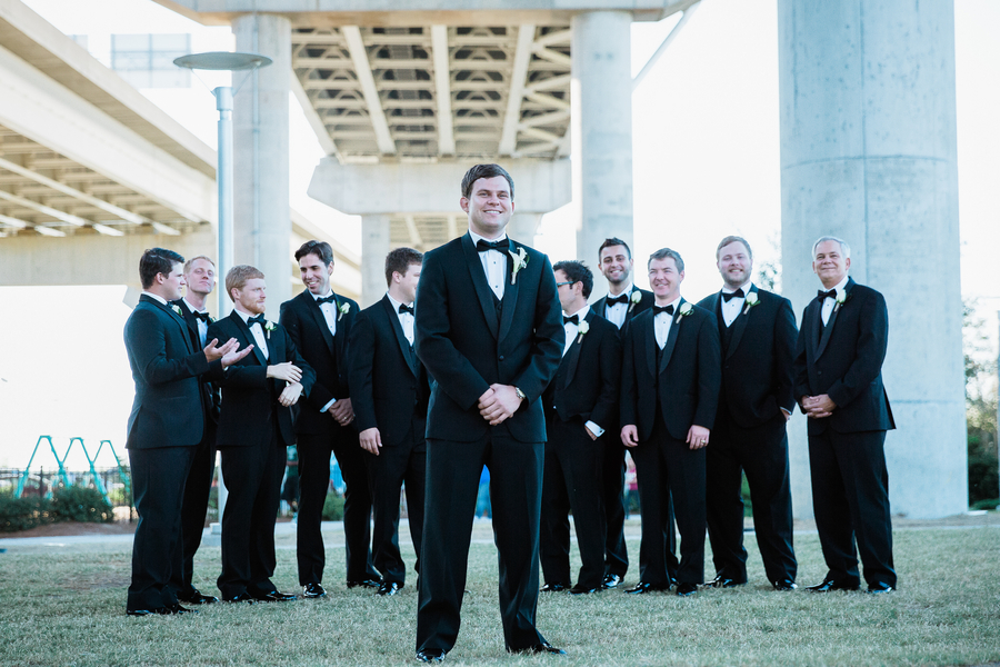Charleston wedding groomsmen in black tuxedos at Cooper River Room by Judy Nunez Photography