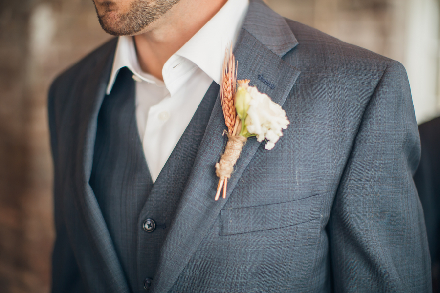 Rustic Charleston wedding boutonniere by Anna Bella Florals at Historic Rice Mill Building
