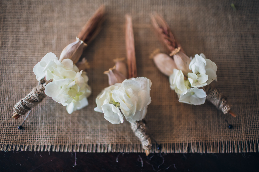 Rustic Charleston wedding boutonniere at Historic Rice Mill Building
