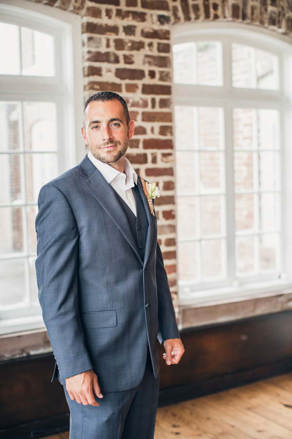 Groom in Grey suit at Charleston wedding at Historic Rice Mill Building