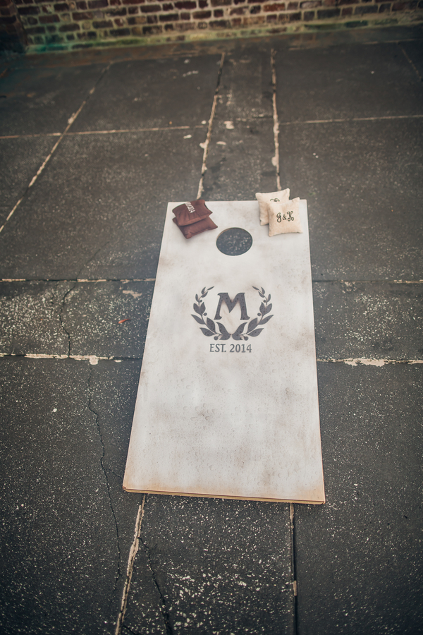 Charleston wedding cornhole boards at Historic Rice Mill Building