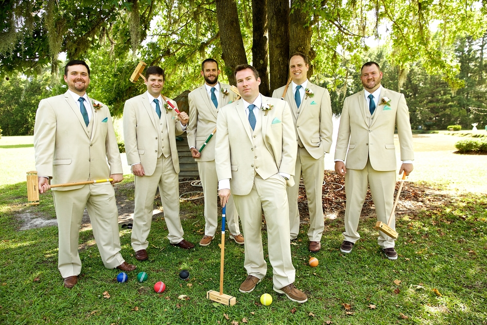 Groomsmen in Tan suites at Christine Kohler + Brook Bristow's Charleston wedding at Old Wide Awake Plantation