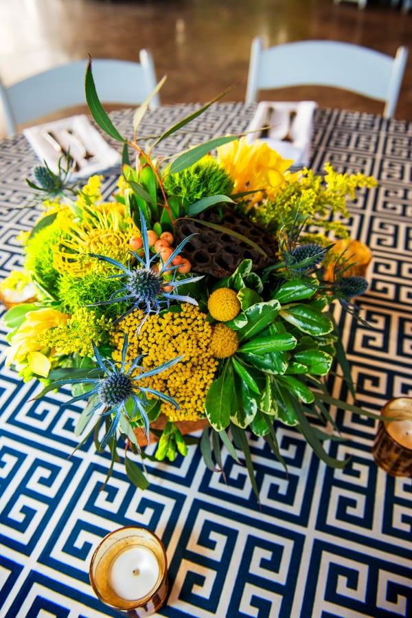 Eclectic yellow, green and blue centerpieces by Ooh! Events at Patriots Point rehearsal in Charleston, Sc