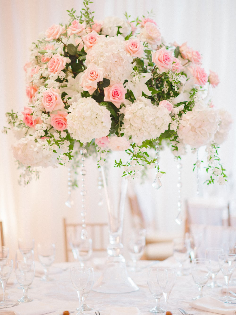 Tall pink rose and white hydrangea centerpiece by Blossoms Event at DeBordieu, SC wedding
