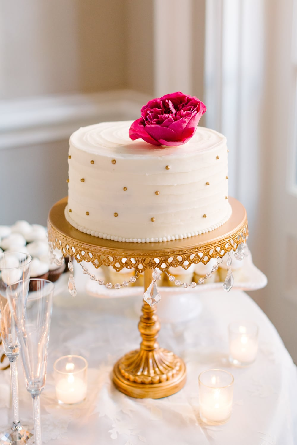 Gold polka dot cake by Ashley Bakery at Mills House Hotel wedding