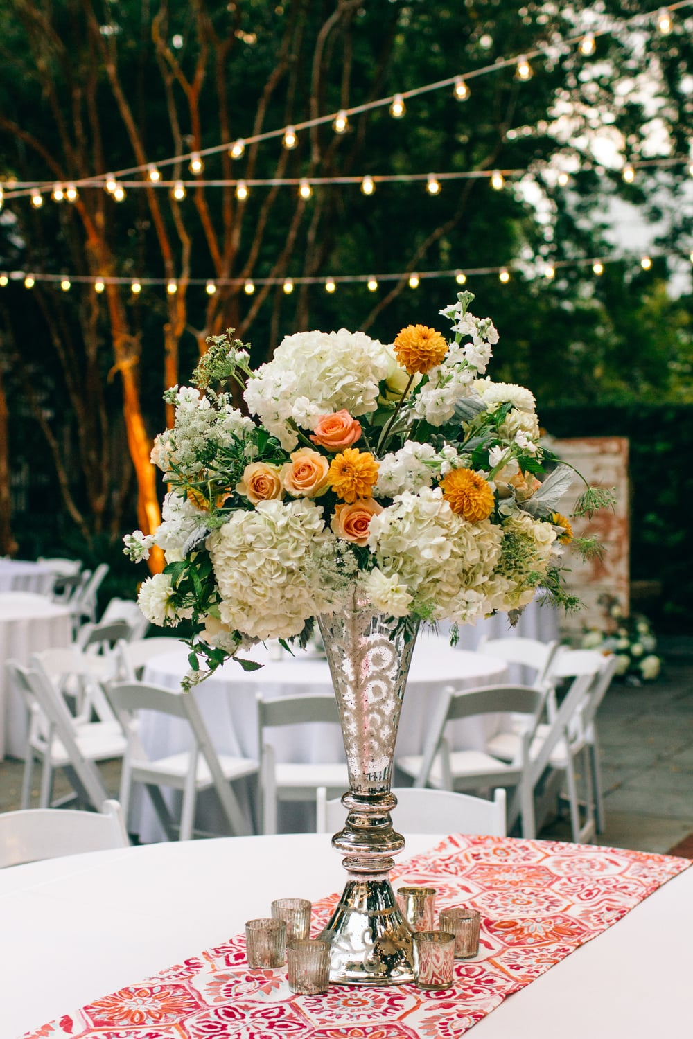 Tall White hydrangea and peach rose centerpieces at Tierney + Joe's Gibbes Museum wedding in charleston, SC