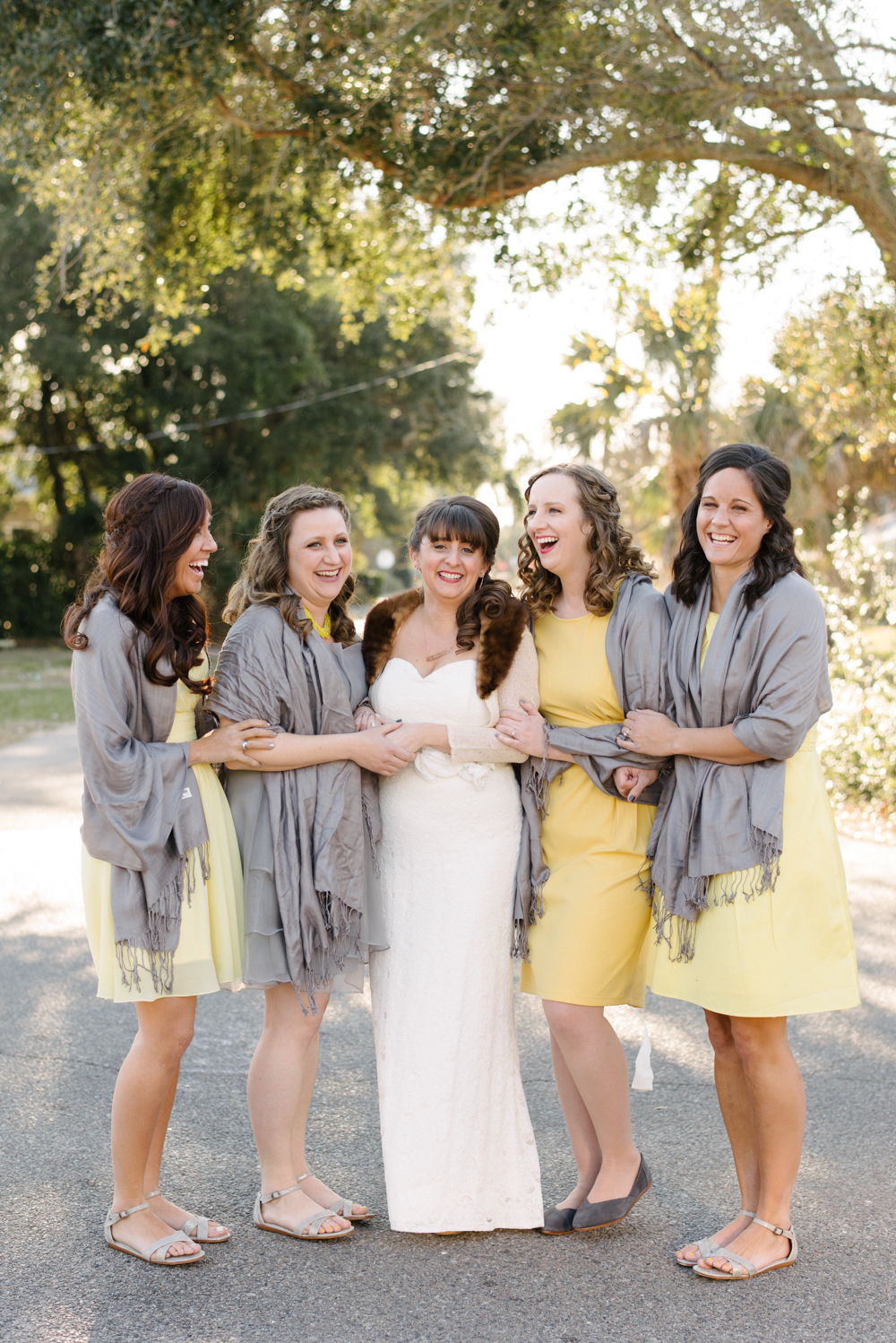 Yellow bridesmaids dresses with grey wraps by Sean Money + Elizabeth Fay.