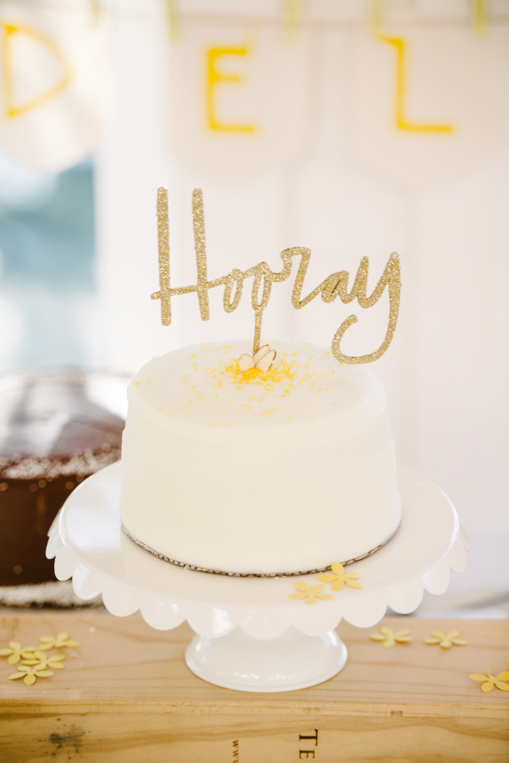 White cake by sugar bakeshop at Cottage on the Creek weddding