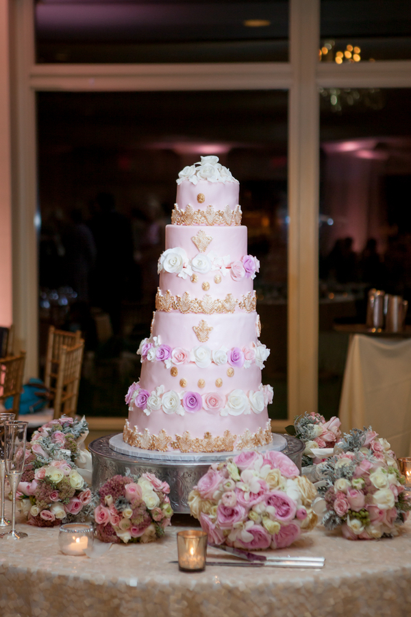 Six Tiered Pink Cake by buttercream cakes and catering at Dunes Beach and Golf Club wedding