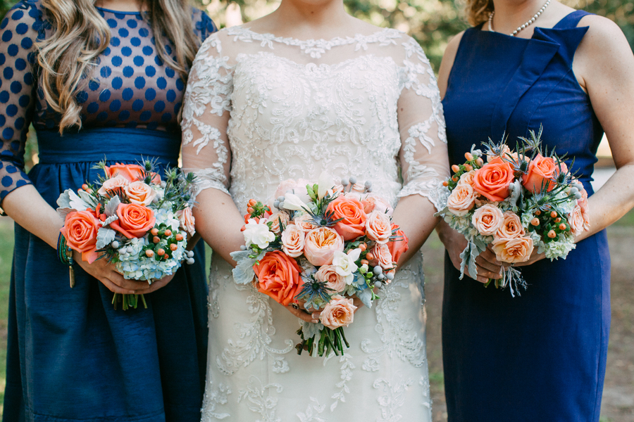 Blue Bridesmaids Dresses with peach bouquets by Riverland Studios.