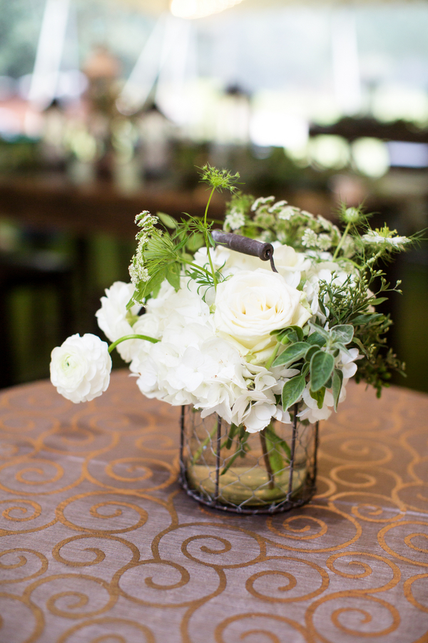 Rustic white centerpieces from Blossoms Events at Caledonia Golf & Fish Club wedding by Myrtle Beach vendor Magnolia Photography