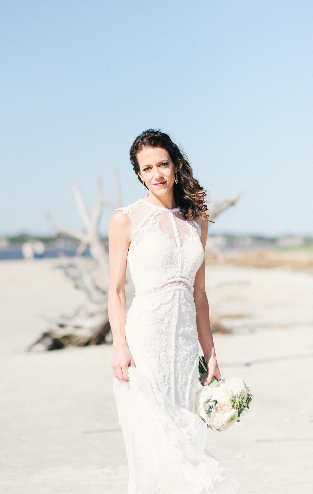 Bride at Driftwood beach on Jekyll Island, GA by Meghan Newsome Photography