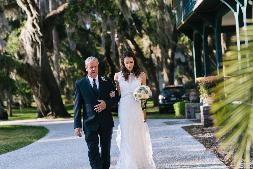 Bride and Father walking down the aisle at Outdoor wedding ceremony at Moss Cottage by Meghan Newsome Photography