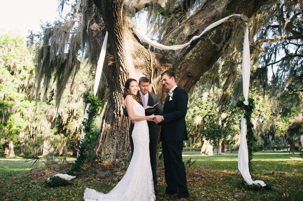 Kadi + Matt's Outdoor wedding ceremony under the oak trees and Spanish moss at Moss Cottage by Meghan Newsome Photography