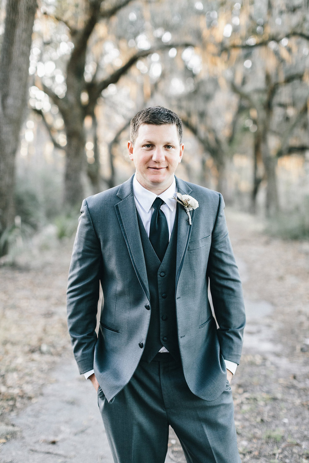 Groom in grey suit at Savannah GA Wedding ceremony by Mackensey Alexander