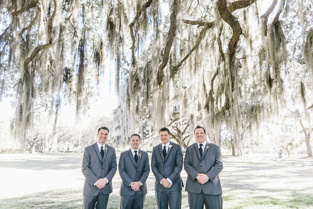 Groomsmen in grey suits at Savannah GA Wedding at Bethesda Academy's Whitfield Chapel by Mackensey Alexander