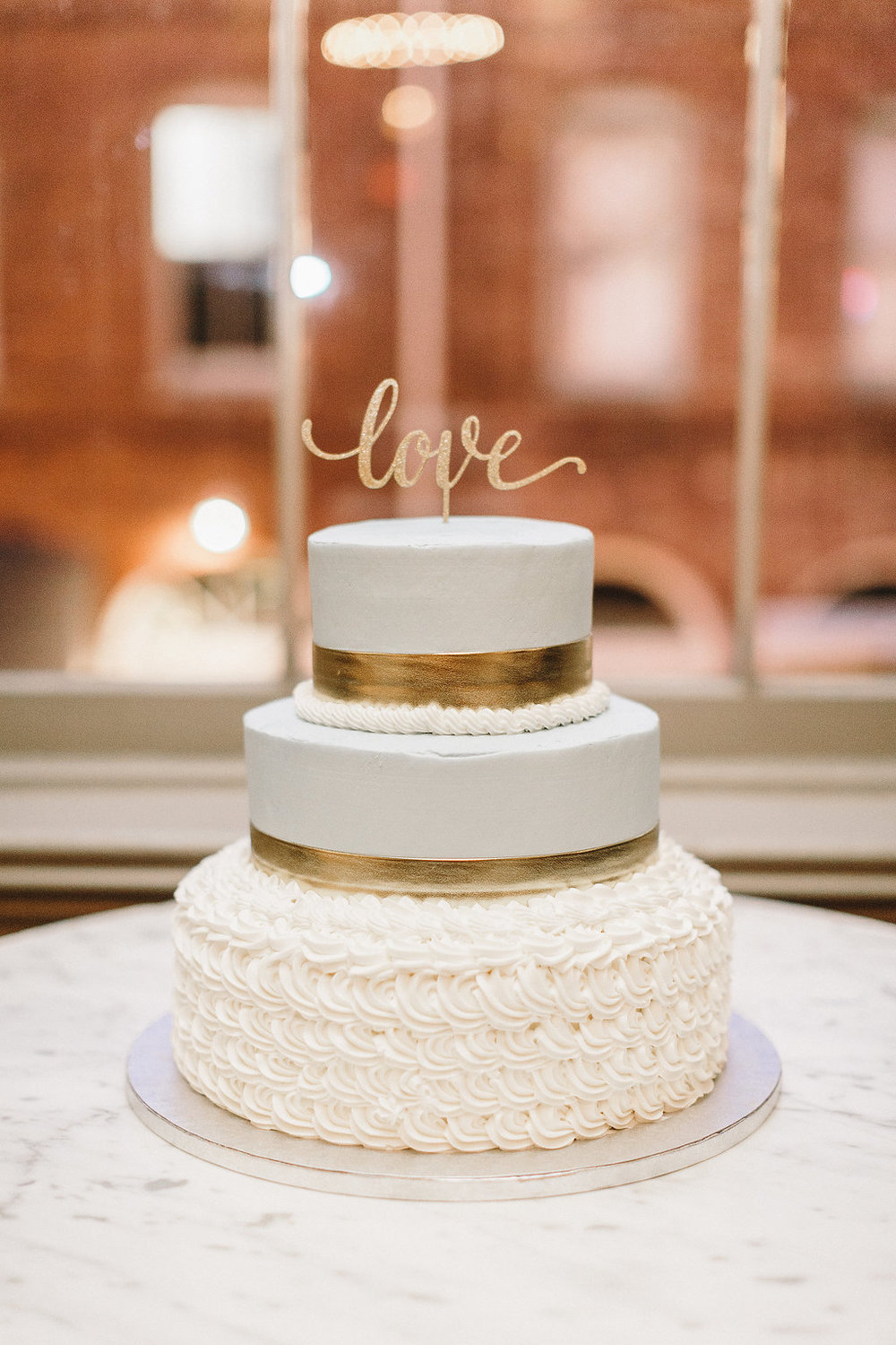White and Gold Savannah wedding cake at Garibaldi's Cafe