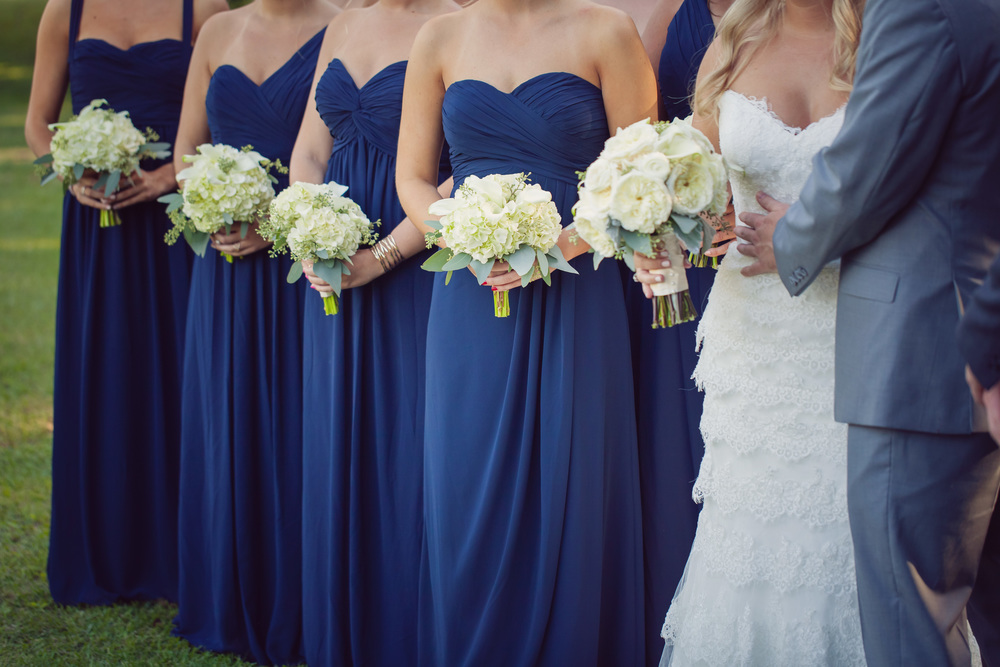 Strapless navy bridesmaids dresses with white hydrangea bouquets at Lowcountry wedding in Charleston, South Carolina