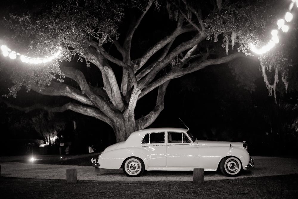 Vintage car getaway at Charleston wedding at The Island House