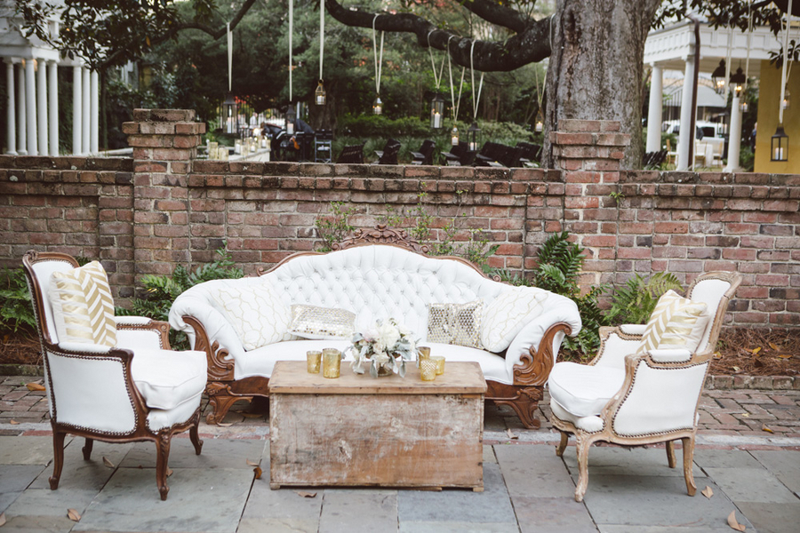 White and gold lounge furniture at Charleston wedding designed by Boutique Planning