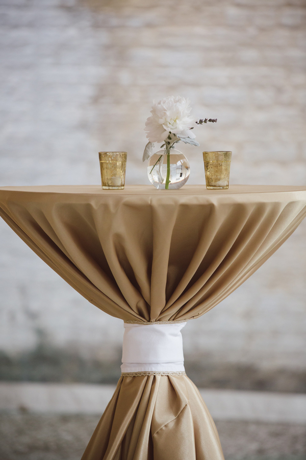 Gold table linens at Charleston wedding designed by Boutique Planning