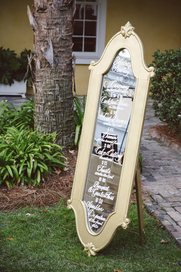 Calligraphed wedding timeline mirror at Charleston, South Carolina wedding