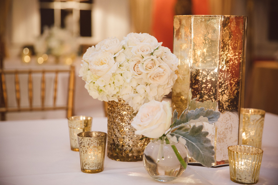 White hydrangea and rose centerpieces in mercury glass at Charleston wedding by Branch Design Studio