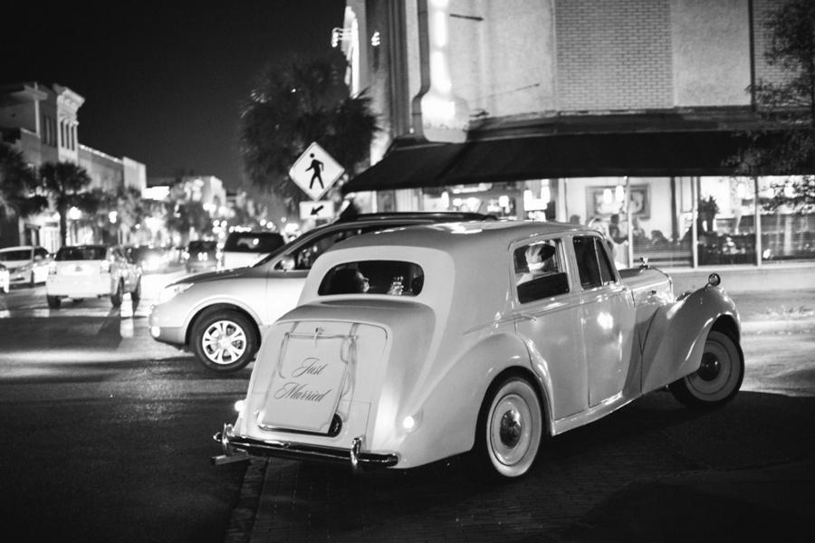 Vintage Rolls Royce getaway car at Charleston wedding on King Street