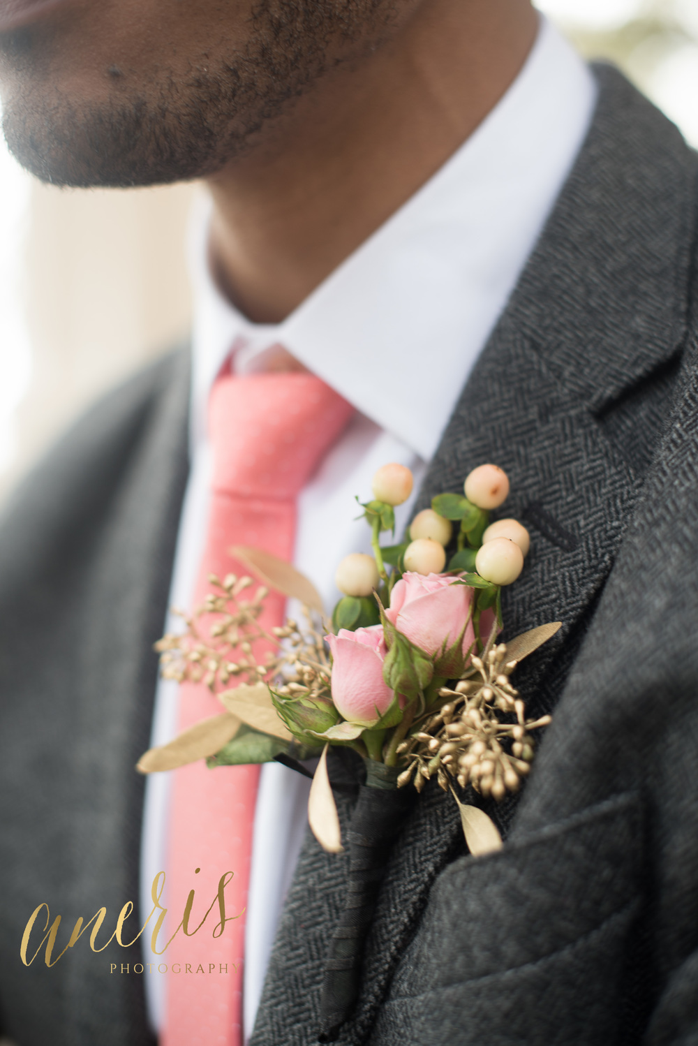 Charleston groom's grey suit with pink boutonniere by Aneris Photography