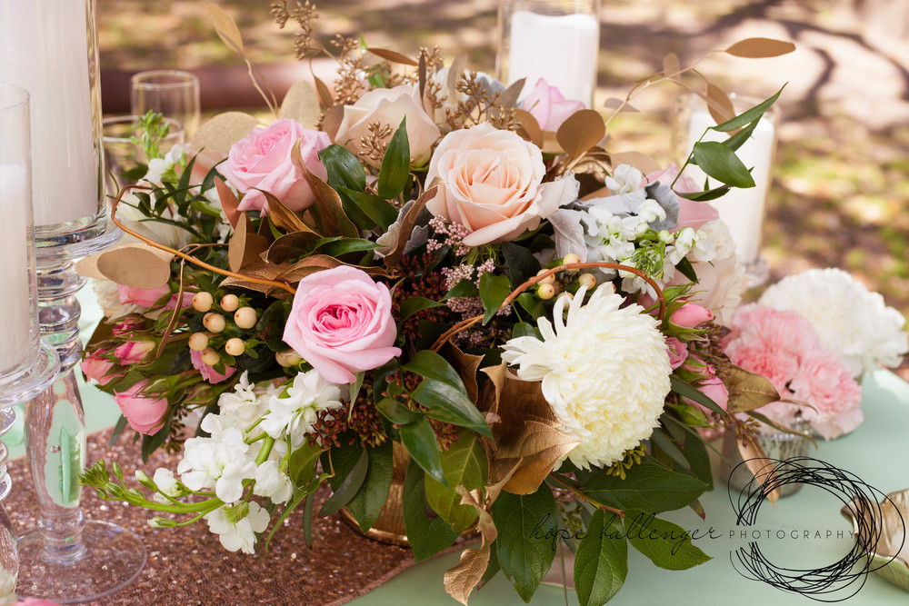 Charleston wedding centerpieces by Lush Floral and Event Stylist with pink roses, carnations and dusty miller