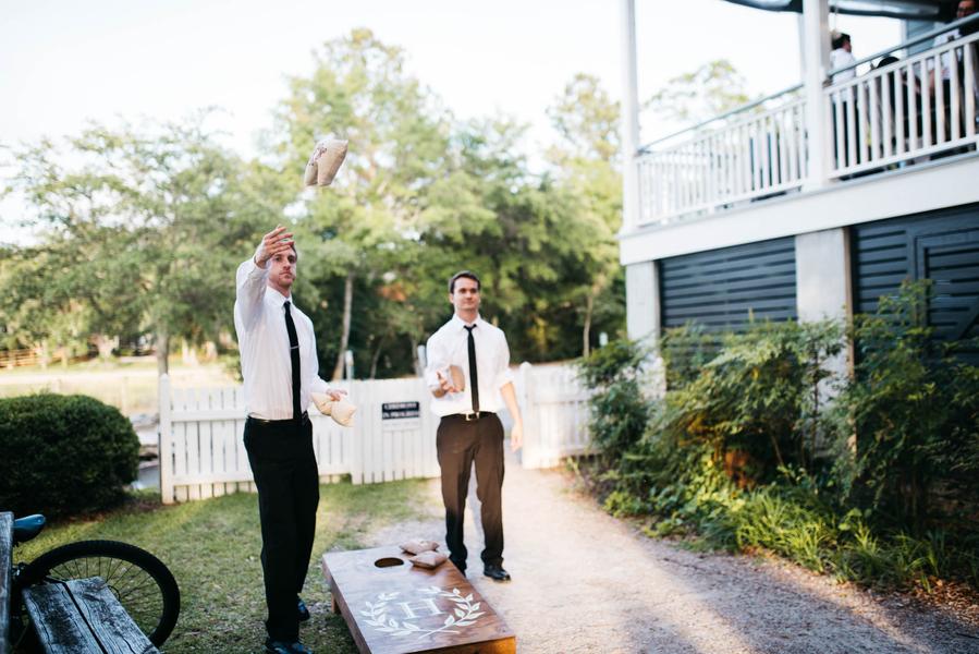 Cornhole boards at outdoor wedding in Charleston, South Carolina