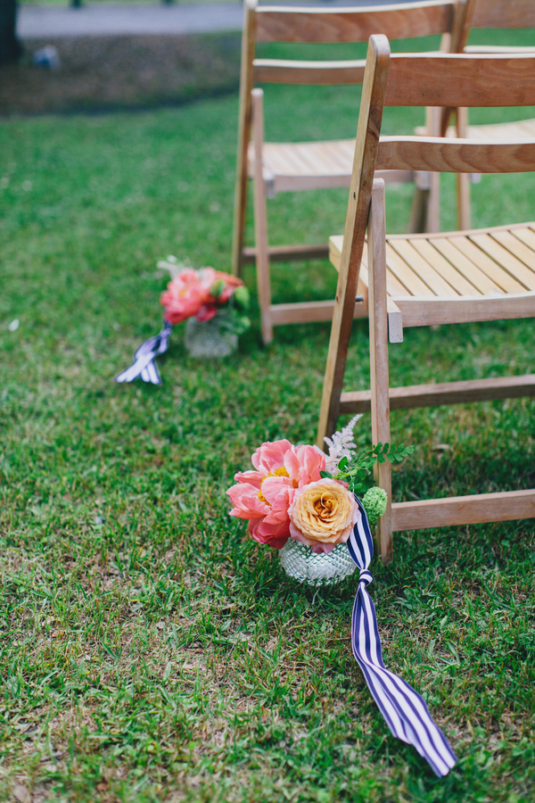 Pink peony and orange rose ceremony flowers at Charleston, SC wedding
