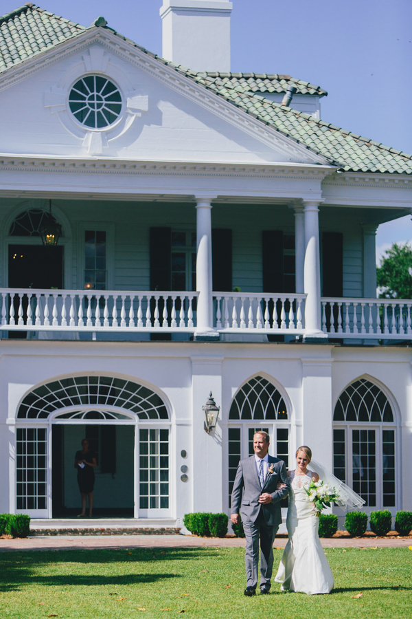 Bride walking down the aisle at Lowndes Grove Plantation in Charleston, SC